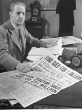 Harry Ferguson in His Office at His Desk with Collection of American Papers Clipps About His Suit Premium Photographic Print