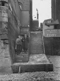Englishmen Chatting as They Stand on Wapping Old Stairs Which Is a Great Thames Landmark Photographic Print by Carl Mydans