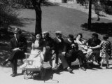 Jewish Families Sitting in the Sun During Visit to a Park Premium Photographic Print