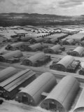 Aerial View of Quonset Huts Being Used for Storage and as Quarters for Military Personnel Premium Photographic Print by J. R. Eyerman