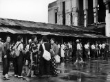 People Lining Up to Buy Tickets at the Railway Station Premium Photographic Print by J. R. Eyerman