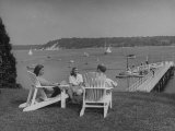 Members of the Country Club Lounging on the Lawn, Watching the Sailboats Premium Photographic Print by Nina Leen