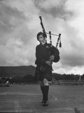 Twelve Year Old Boy Winning First Prize in Both of the Piping Contests Open to Him at Cowal Photographic Print