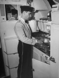 Kitchen on Air Force One Where a Service Man Is Preparing a Meal Premium Photographic Print