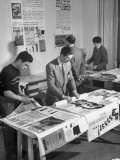 Men Packing Posters at Popular Front Headquarters Premium Photographic Print by Dmitri Kessel