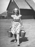 Francis Larson Collecting Eggs on Her Farm Premium Photographic Print by Bob Landry