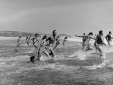 Lifeguards and Members of Womens Swimming Team Start Day by Charging into Surf Fotografie-Druck von Peter Stackpole