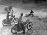 Riders Enjoying Motorcycle Riding, with One Taking a Spill Reproduction photographique sur papier de qualité par Loomis Dean