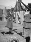 Woman Hanging the Laundry Out to Dry Photographic Print by Nina Leen