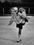 Child Skater Helen Ann Rousselle Holding Doll While Skating across the Ice Premium Photographic Print