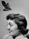 Joan Harris Experiencing a Bat Flying from Her Head, on Museum of Science Show Premium Photographic Print by Yale Joel