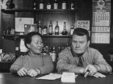 American Barkeeper Frank Yenalevicz Posing with His Chinese Wife in His Bar Premium Photographic Print
