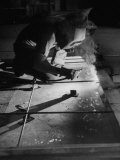 Man Welding Pieces of Metal Together Premium Photographic Print by Allan Grant
