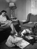 Woman Writing to Her Husband Serving Oversaes While Her Children Play at Her Feet Premium Photographic Print by Alfred Eisenstaedt
