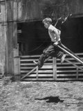 Kenneth Merriman Jumping Down from Stilts Premium Photographic Print