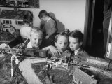 Children Playing with Model Train Premium Photographic Print