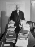 Herbert C. Hoover Standing in Back of Stacks of Reports for Hoover Commission Studies Premium Photographic Print