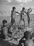 Bushman Children Practicing How to Use a Bow and Arrow Premium Photographic Print