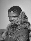 Bushman Woman Wearing Animal Fur to Keep Her Warm Premium Photographic Print