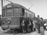 Crowds of People Boarding Street Car for Black Market Trip Premium Photographic Print