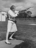 Pat Laursen, National Women's Skeet Shooting Champion, Taking Aim in Crouching Stance Premium Photographic Print by Alfred Eisenstaedt