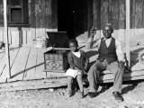 Sharecropper, Lonnie Fair and Daughter Listen to Victrola on Farm in Mississippi Premium Photographic Print by Alfred Eisenstaedt