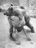 An Iranian Performace of a Man Wrestling a Bear in Public Photographie par Dmitri Kessel