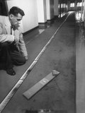 Solar Expert Robert S. Richardson Studying Sun's Spectrum on 40-Ft. Long Strip of Photographs Premium Photographic Print by J. R. Eyerman