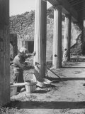 Workman Repairing One of the Fifty Bomb Damaged Spots in the Ruins of Pompei Premium Photographic Print by Alfred Eisenstaedt