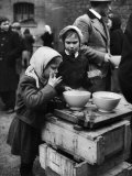 Pair of Russian Children Having a Meal of Molasses Bread and Coffee in a Displaced Persons Camp Premium Photographic Print