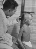 Flashes from A-Bomb Burned Boy Who Is Being Examined by A.B.C.C Premium Photographic Print by Carl Mydans