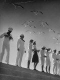 Seagulls Flying Above Group of Sailors and Waves Fotoprint van Alfred Eisenstaedt