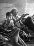 Jewish Woman and Child Receiving Arab-Supplied Bread at Hospital Premium Photographic Print
