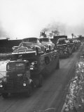 Newly-Made Pontiacs Being Transported on Trucks Photographic Print by Ralph Morse