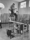 Children Playing on a Giant Erector Set Premium Photographic Print