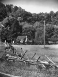 Abraham Lincoln's Childhood Home with a Rail Fence That He Built Photographic Print by Ralph Crane
