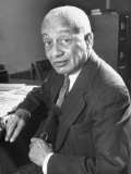 Portrait of Philosopher Alain Leroy Locke Sitting at Desk in Office at Howard University Fotoprint van Alfred Eisenstaedt