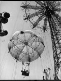 Thrillseeking Couple Take a Ride on the 300-Ft. Parachute Jump at Coney Island Amusement Park Photographic Print