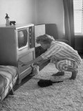Young Woman Attending to Her Housework by Dusting Off Her Television Set Premium Photographic Print by Nina Leen
