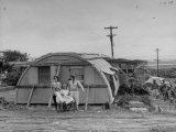 "Major Sidney Shelley and His Family Living in a ""Typhoonized"" Quonset Hut Premium Photographic Print by Carl Mydans"