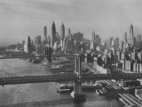 New York City Behind the Brooklyn and Manhattan Bridges That are Hovering over the East River Photographic Print by Dmitri Kessel