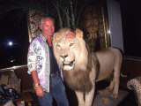 Designer Gianni Versace Beside Stuffed Lion at Sly Stalone's Home Premium Photographic Print