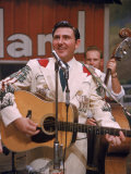 Webb Pierce Performing During Grand Ole Opry Broadcast Premium Photographic Print by Yale Joel