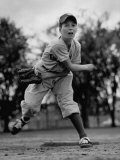 Boy Playing a Game of Little League Baseball Premium Photographic Print by Yale Joel