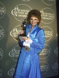 Singer Reba Mcentire Holding Her Award in Press Room at Academy of Country Music Awards Premium Photographic Print
