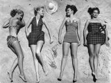 Models Lying on Beach to Display Bathing Suits Premium Photographic Print by Nina Leen