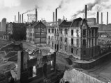 August Thyssen Steel Mill, Large Steel Works, Looming Smokily Behind Bomb-Ruined Town Premium Photographic Print by Ralph Crane