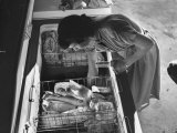 Woman Reaching Further into the Home Freezer and Pulling Packages of Frozen Vegetables Premium Photographic Print by Ed Clark