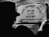 Man Loading Butter in Northern Ireland to Smuggle into Ireland Premium Photographic Print