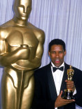Actor Denzel Washington Holding His Oscar in Press Room at Academy Awards Premium Photographic Print